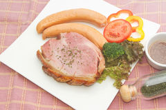 Smoke ham staek with smoked sausage Stock Photo