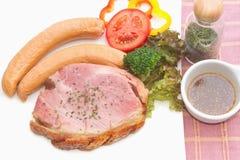 Smoke ham staek with smoked sausage Royalty Free Stock Photography