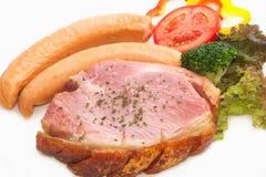 Smoke ham staek with smoked sausage Stock Photos