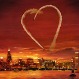 Smoke Heart. Airplanes making heart from smoke in evening sky Royalty Free Stock Photo