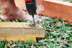 Smoke and heat from an electric drill. Stock Photos