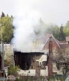 Smoke of a house fire Stock Photos
