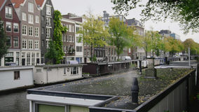 Smoke from houseboats along canals, Amsterdam, Netherlands Royalty Free Stock Photos