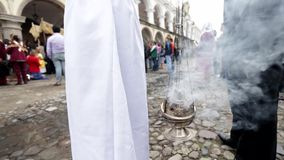 Smoke of incense being burned on a thurible censer burner at cermony on the streets Royalty Free Stock Photo