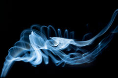 SMOKE. Of incense on black background Royalty Free Stock Photography