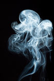 SMOKE. Of incense on black background Royalty Free Stock Images