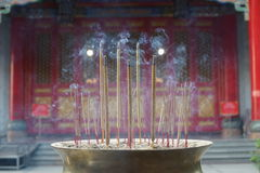 Smoke incense stick. Incense stick with smoke in temple Royalty Free Stock Photos