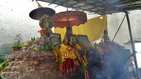 Smoke  of incense sticks in air of abandoned temple Stock Image