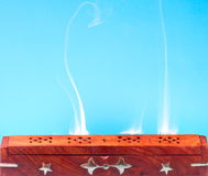 Smoke of Indian incense. Smoke of Tibetan incense on the blue background Royalty Free Stock Photos
