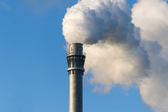 Smoke from an industrial chimney against the blue sky, copy spac Stock Photo