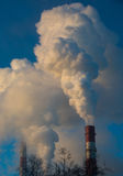 Smoke from industrial chimneys at dawn in the city Royalty Free Stock Image
