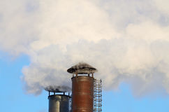 The smoke from industrial chimneys. Stock Images