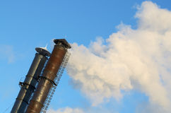 The smoke from industrial chimneys. Royalty Free Stock Photos
