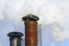 The smoke from industrial chimneys. Stock Photography
