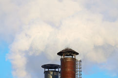 The smoke from industrial chimneys. Royalty Free Stock Images