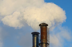 The smoke from industrial chimneys. Royalty Free Stock Image