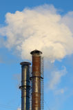 The smoke from industrial chimneys. Stock Photo