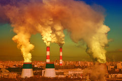 Smoke from industrial pipes. Bright acid colors. Thick smoke from thermal power plants over the residential areas of the city factory Royalty Free Stock Images
