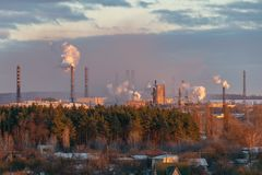 Smoke from industrial pipes on the outskirts of the city stock photography