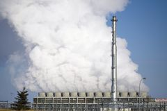 Smoke from industrial plant. Industrial steam stacks giving off steam Royalty Free Stock Photo