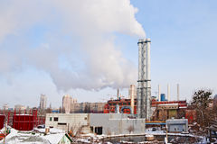 Smoke from industrial plant in center of big city. Smoke from industrial plant in city center. Kiev, Ukraine Royalty Free Stock Photo