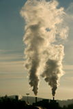 Smoke from industry. Two chimneys spread smoke vertically Royalty Free Stock Images