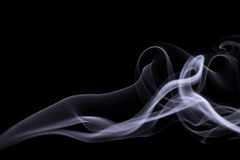Smoke isolated on black. Grey smoke in shape of woman isolated on black Stock Photos