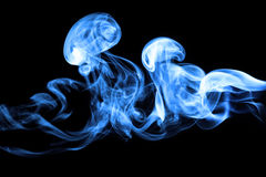 Smoke isolated on deep black background Stock Photos