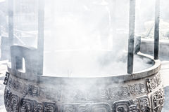The smoke from joss stick metal pot. At temple in Ling Shan Royalty Free Stock Images