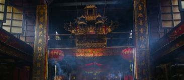 Smoke of joss stick in old chinese temple. Ceremony Stock Photo