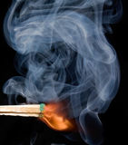 Smoke from a lighted match stock images