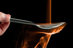 Smoke made to look like fire pouring on a spoon. Stock Photography