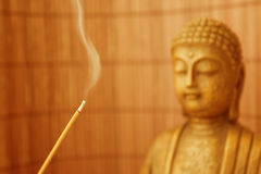 Smoke Meditation with Buddha Head 02. Buddha sculpture and smoke for meditation royalty free stock photography
