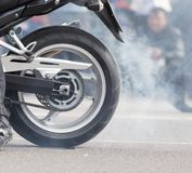 The smoke of motorcycle wheels. In the park in nature royalty free stock photography