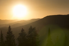 Smoke From Nearby Colorado Forest Fires Diffuses This Vail Sunset Royalty Free Stock Photos