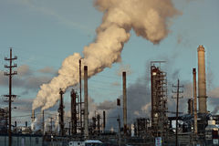 Smoke at Oil Refinery Stock Images