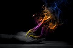 Smoke out of palm. Colorful smoke coming out of the palm Stock Photography