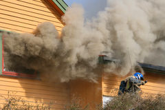 Smoke out the window Royalty Free Stock Images