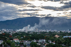 Smoke over the city - Fire in the city overview. Stock Photos