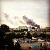 Smoke over city. Stock Photos