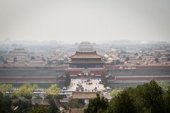 China, Beijing, Forbidden City. Smoke over the Forbidden City, Beijing, China stock photography