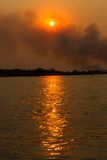 Smoke over the Okavango River Stock Photo
