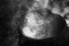 Smoke from a part of an old iron furnace stock photography