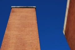 Smoke pipe. A big smoke pipe with a blue sky Royalty Free Stock Photos