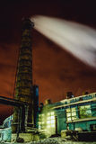 Smoke of the pipe of factory at night Stock Image