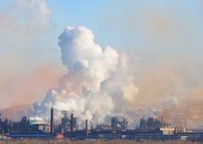 Smoke pipe. Metallurgical factory. Metallurgical factory. Environmental contamination. Smoke pipe stock image