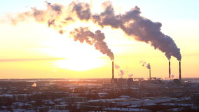 Smoke from pipe of termal power station. In winter sunset stock video footage