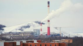 Smoke from pipe of thermal power station in winter. City landscape. City landscape. Industrial town. Smoke from chemical plant stock footage