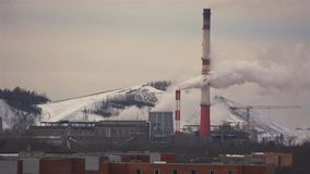 Smoke from pipe of thermal power station in winter. City landscape. City landscape. Industrial town. Smoke from chemical plant stock video footage