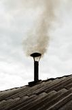 Smoke pipe village bathhouse. Цood fueled oven in Russian bath Royalty Free Stock Photography